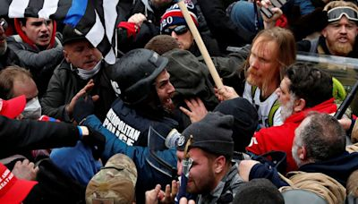 Capitol rioter seen attacking law enforcement with baseball bat turns himself in