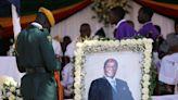 Zimbabwe's Mugabe buried in home village, ending an era