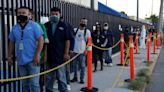 Workers return to Mexico's border factories as auto sector reopens