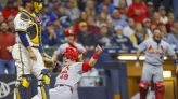 Cards win 11th in row, best streak since 2001; stall Brewers