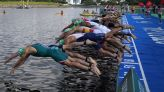 Camera boat nearly runs over swimmers with outboard motor in bizarre false start at Olympics triathlon