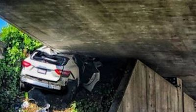 How did a Maserati end up wedged beneath this California overpass?