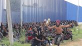 Over 200 African men cross from Morocco into Spain's Melilla