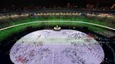 Pandemic-delayed Tokyo Summer Olympic Games kick off to mostly empty stadium