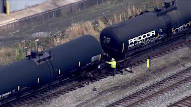 Cranes upright derailed CSX train cars in Baltimore