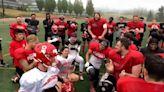 College football teammates celebrate Canada's first female football scholarship