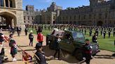 Royal Family members walk behind coffin
