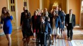 FILE PHOTO: House Republicans who oppose mask mandates march as a group to the Senate chamber to highlight different coronavirus disease (COVID-19) mask rules between the House and Senate sides of the U.S. Capitol in...