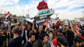 Iraqis rally to revive year-old revolt against the system