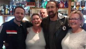 Cage spends New Year's Eve in a small pub - and gets everyone a drink