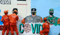 Indonesia's regional COVID-19 deaths higher than national tally - data monitor