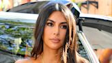 Kim Kardashian Brings Her Black Gym Look a Sunny Boost With Yellow Yeezy Sneakers