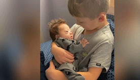 Big Brother Sings Love Song To Infant With Downs In Precious Home Video.