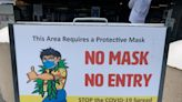 The CDC says masks for the vaccinated are optional. As COVID cases climb, some feel differently.