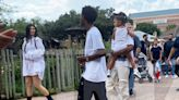 Kylie Jenner Hides Her Baby Bump Under Baggy Shirt At Houston Zoo With Travis & Stormi