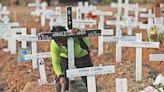 Graveyard mementos in Indonesia mark virus's toll