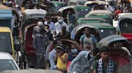 Travel Restrictions Begin as India's COVID Crisis Continues