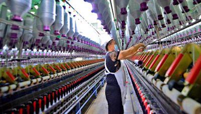越南逐步解封 紡纖廠拚回神 - 工商時報