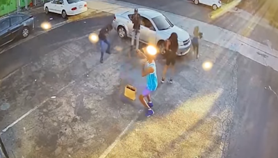 Armed shopper shoots would-be robbers and fends off assailants in dramatic scene