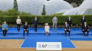 'Are you supposed to be looking as if you're enjoying yourself?': Queen Elizabeth II poses for G-7
