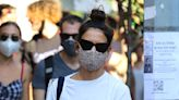 Katie Holmes Does Big-Toe Strappy Sandals With a Box Tee for Antiquing