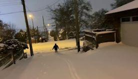 Heavy Snow Turns Streets Into Ski Slopes || ViralHog