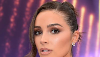 Olivia Culpo Masters Two Trends in One With a Puff Sleeve Top, Knit Mini Skirt & Buzzy Square Heels
