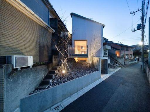 優雅潔白的塔形建築 以有限面積柔緩流通東京郊外的安閒輕巧