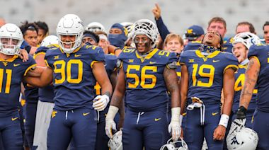 West Virginia players sing 'Take Me Home, Country Roads' to families after rout