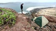 Migrants leave Red Cross camp for island cliffside