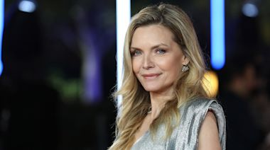 Michelle Pfeiffer transforms into the lady in red (hair) for new film