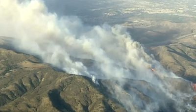 Orange County under siege by wildfires; 2 firefighters gravely burned