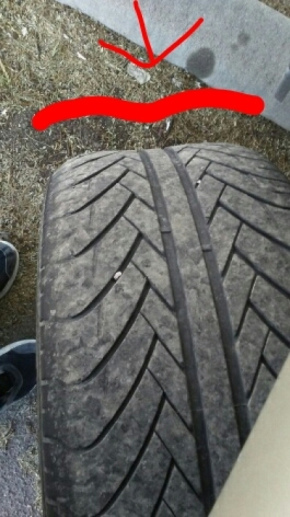 What causes a bilateral bulging out on the tread portion of a tire.?