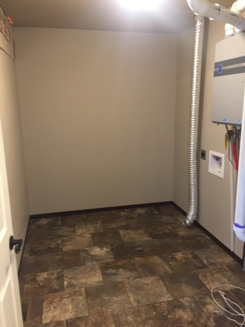 How do I know if my rental has a hookup for gas or electric dryer?