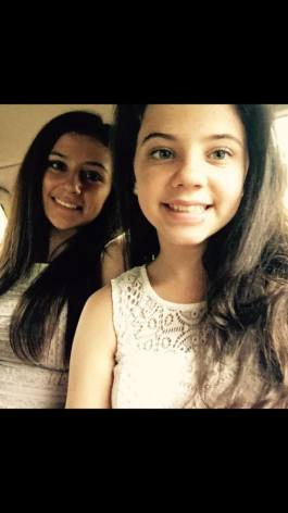 Who is prettier??? Me or my older sis(in the back)....plz answer, thx. :)?