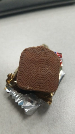 How is this iconic mark on the bottom of snicker bars made?
