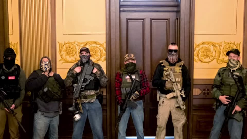 Armed protesters in Michigan decry lockdown extension