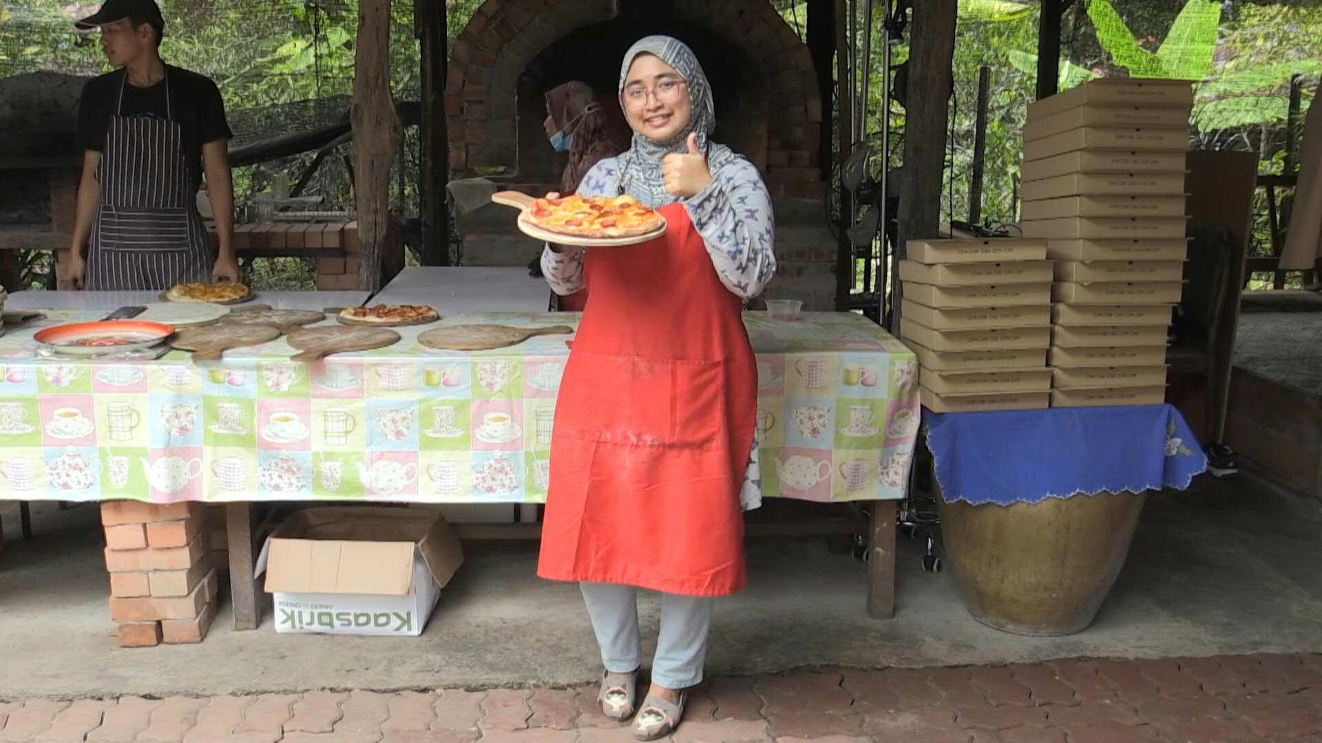 uk.news.yahoo.com: Pandemic pizza: Malaysian family cooks up solution to virus woes