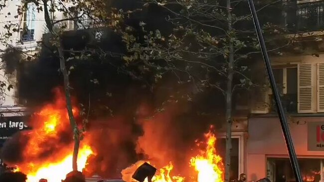 Fires Burn Near Bastille Square in Paris During Protests Against Security Bill