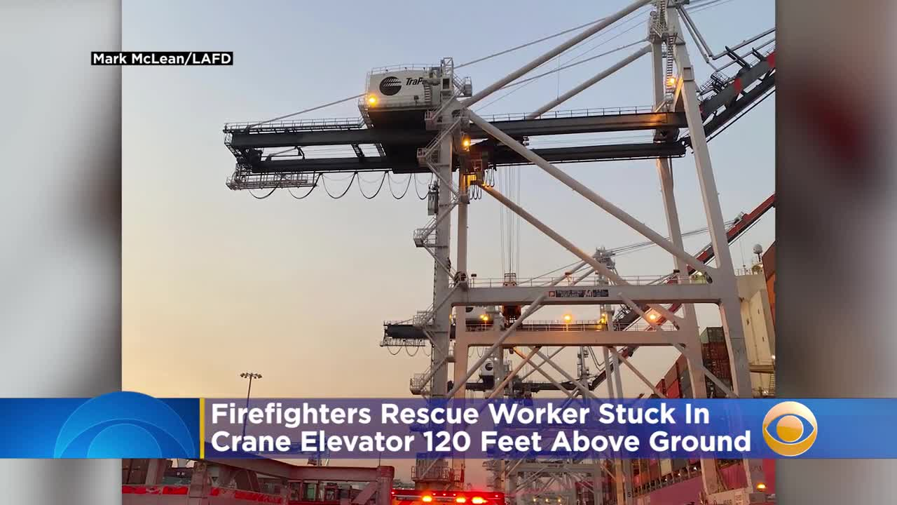 news.yahoo.com: Firefighters Rescue Port Of LA Worker Stuck In Crane Elevator 120 Feet Above Ground