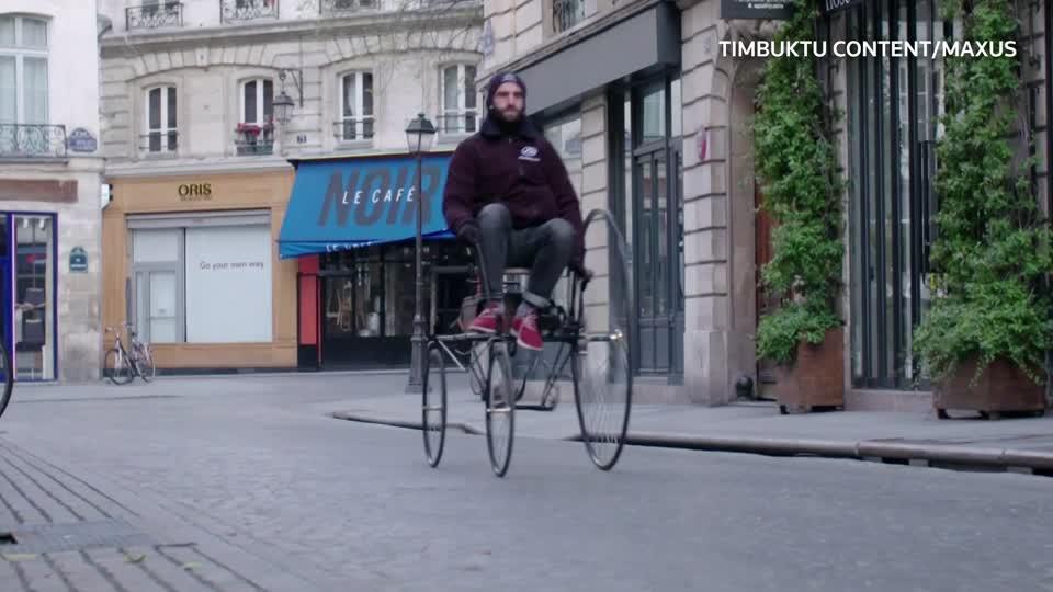 Replica of 'first' electric car drives through Paris to ...