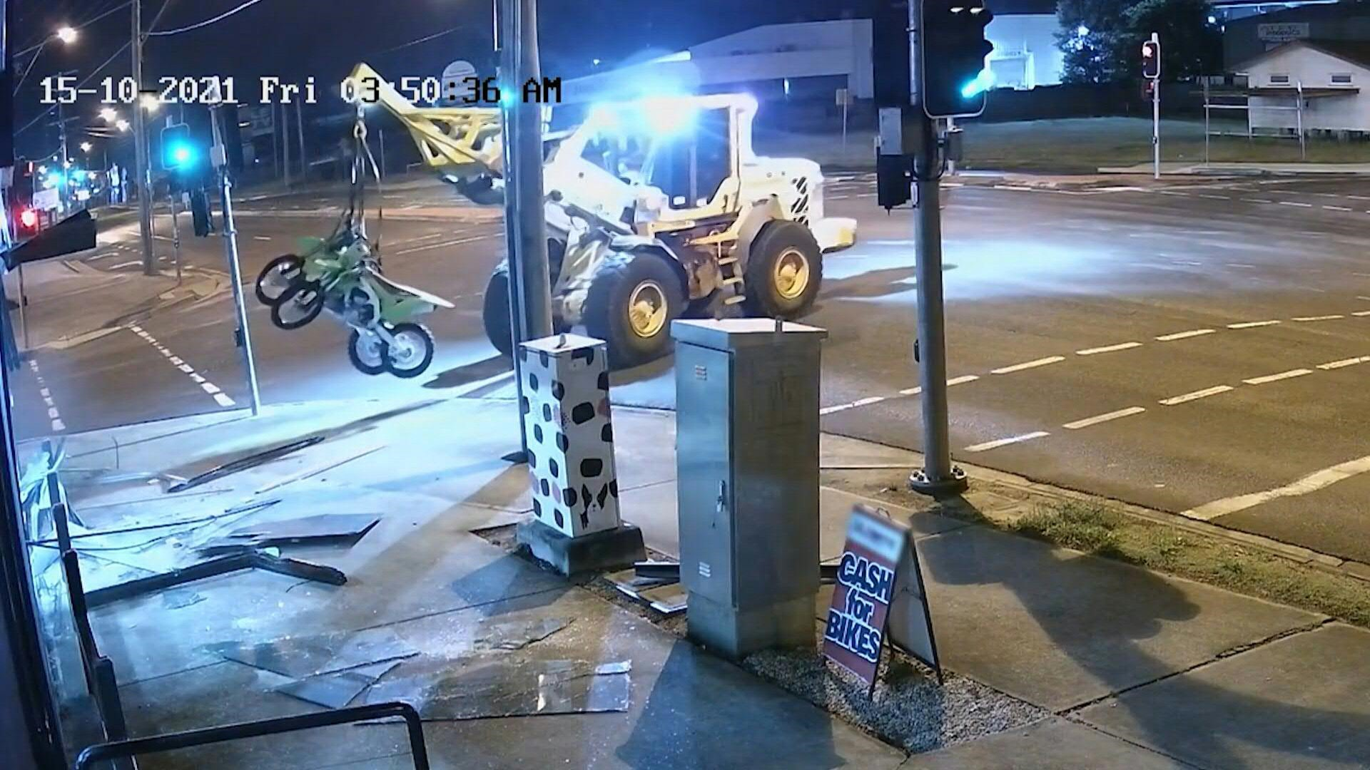 Australian police chase tractor used in daring bike shop ram raid