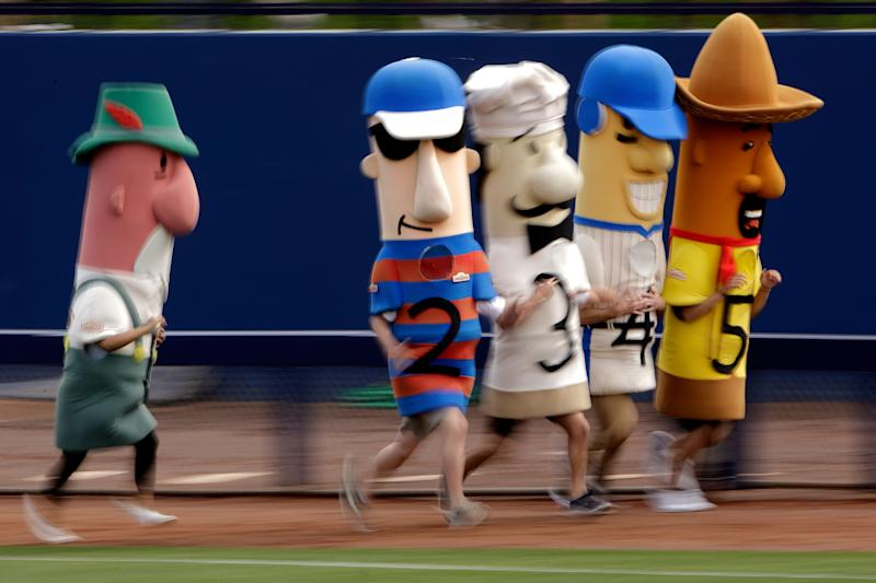 These are the sausage mascots that the Wisconsin GOP wants to keep away from polling sites. (Photo: Charlie Riedel/Associated Press)