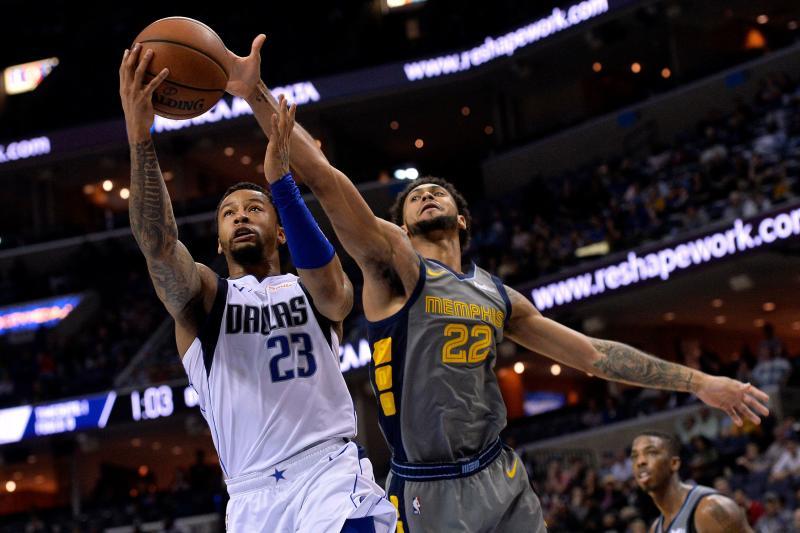 Dallas Mavericks guard Trey Burke (23) shoots against Memphis Grizzlies guard Tyler Dorsey (22) in overtime of an NBA basketball game Sunday, April 7, 2019, in Memphis, Tenn. The Mavericks won 129-127. (AP Photo/Brandon Dill)