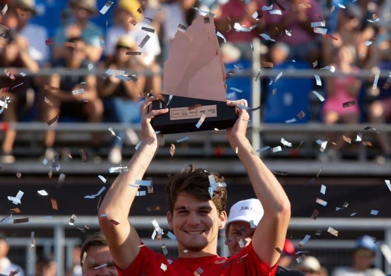 Just like Rafa! Brazil's Thiago Seyboth Wild holds the Santiago trophy