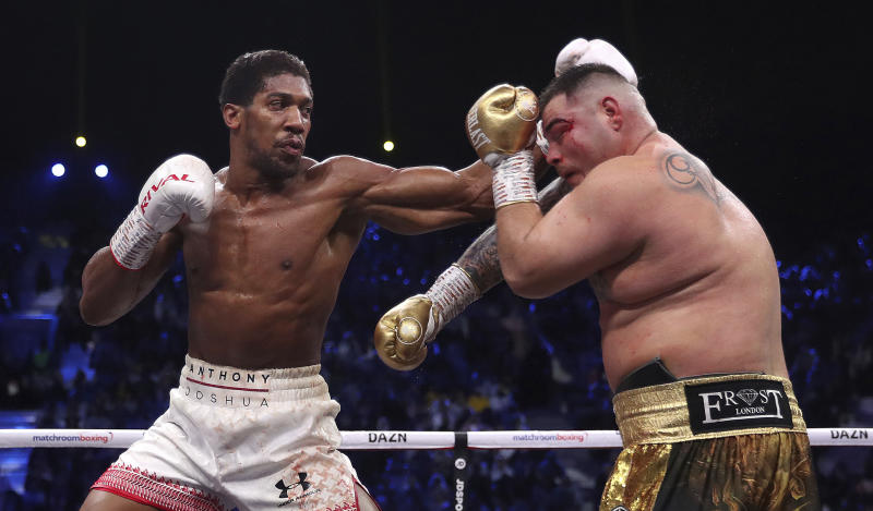 Defending champion Andy Ruiz Jr., right, during his fight against Britain's Anthony Joshua in their World Heavyweight Championship contest at the Diriyah Arena, Riyadh, Saudi Arabia. (Nick Potts/PA via AP)