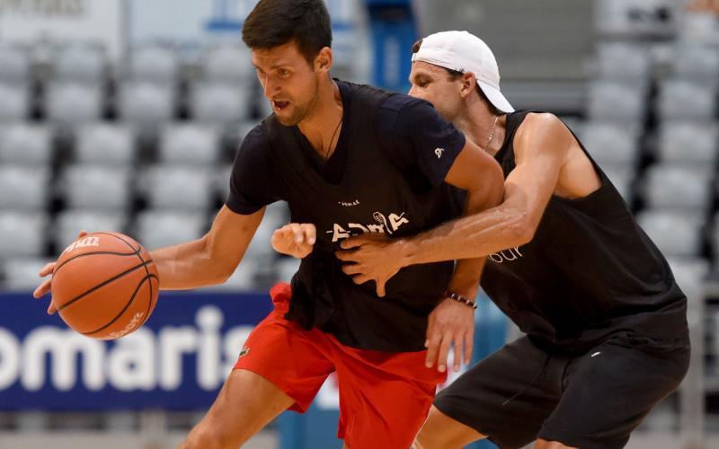 Novak Djokovic and Grigor Dimitrov take part in an exhibition basketball match in Zadar - AFP