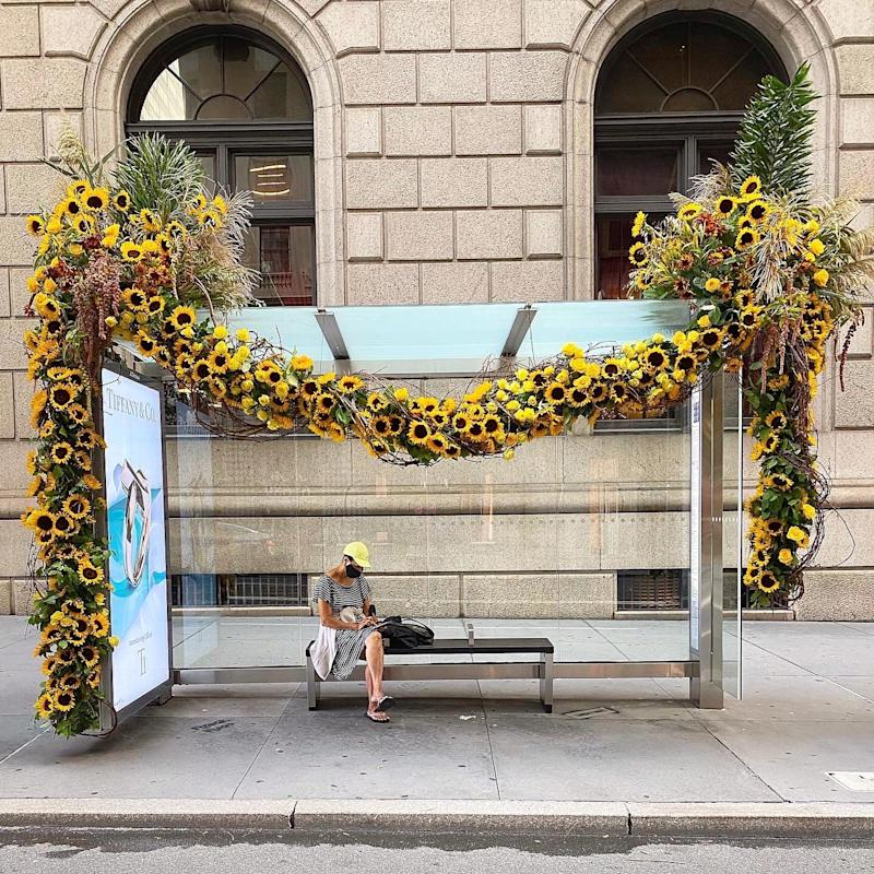 """A Miller-made """"Flower Flash"""" adorns a bus stop in New York City."""