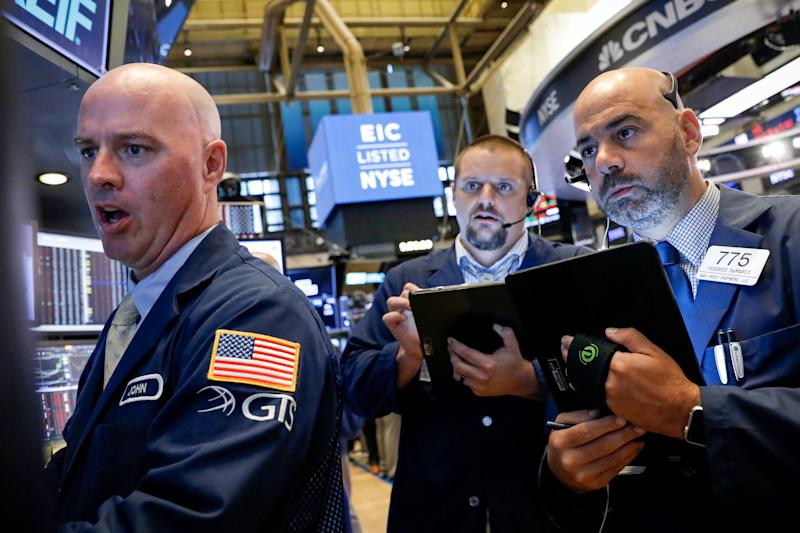 Traders work on the floor at the New York Stock Exchange (NYSE) in New York, U.S., August 7, 2019. REUTERS/Brendan McDermid