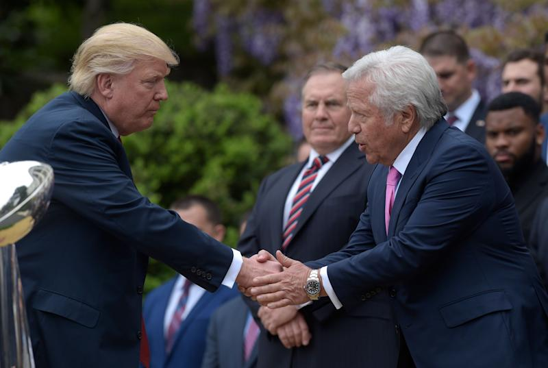 President Donald Trump shakes hands with New England Patriots owner Robert Kraft, accompanied by head coach Bill Belichick, center, during a ceremony on the South Lawn of the White House in Washington, Wednesday, April 19, 2017, where the president honored the Super Bowl Champion New England Patriots for their Super Bowl LI victory.. (AP Photo/Susan Walsh)